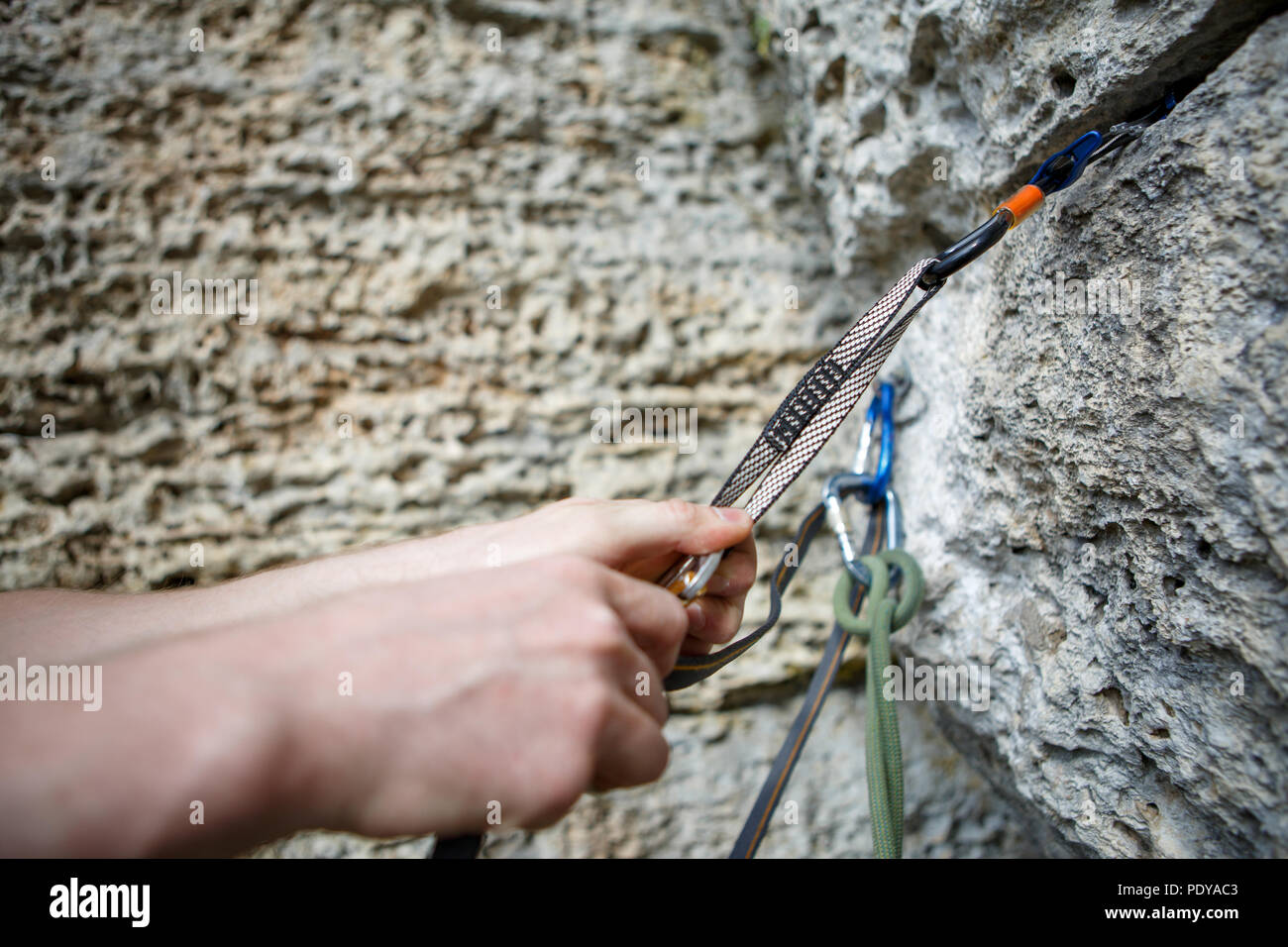 Photo of human's hand hammering up mountain - Stock Image