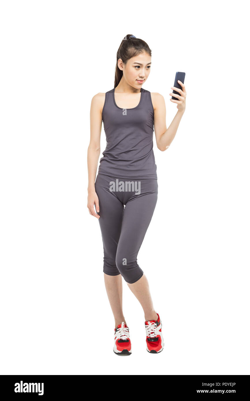 athlete using mobile phone app fitness tracker for tracking weight