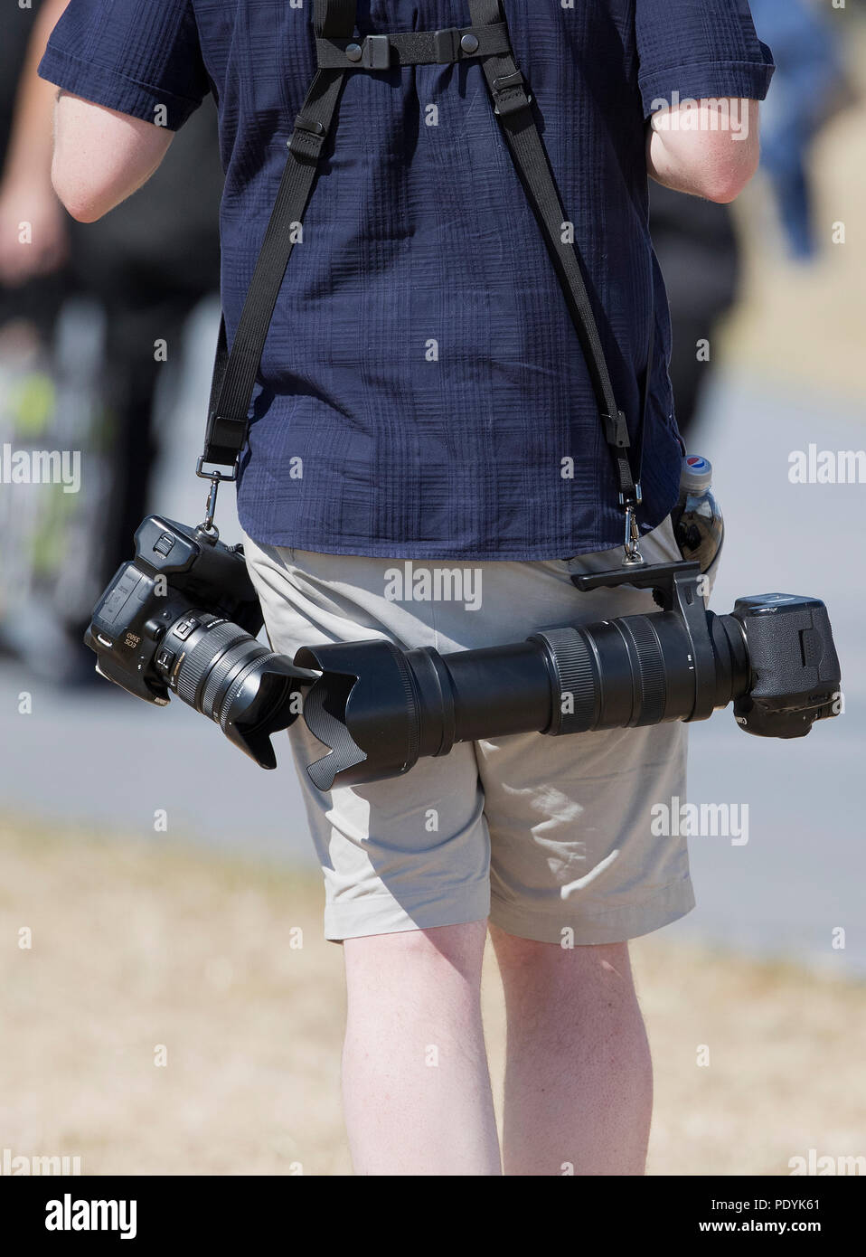 RAF RIAT 2018, man laden with cameras at the air show in Fairford, Gloucestershire,U.K. - Stock Image