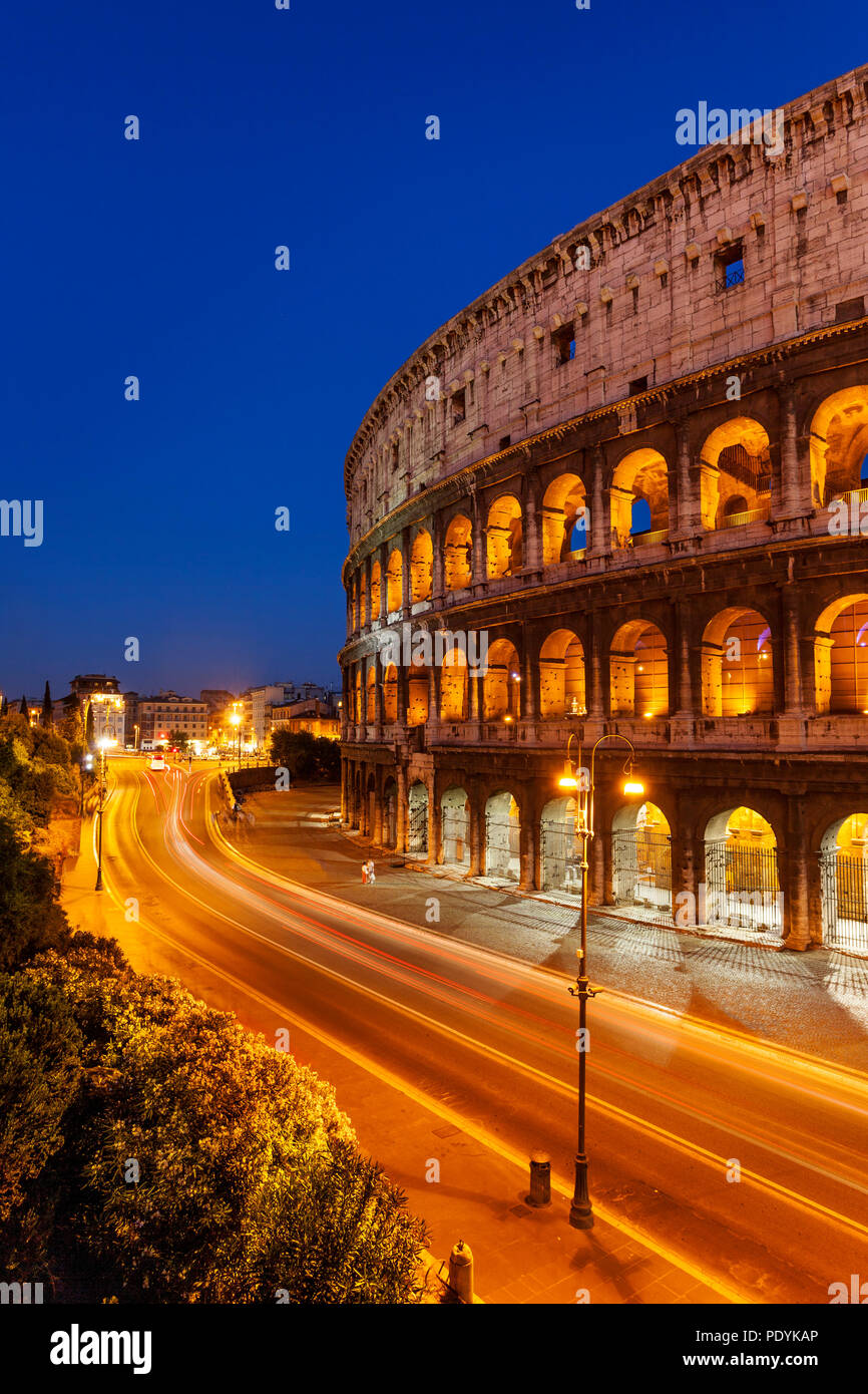 Car light-trails in front of the Roman Coliseum at dusk, Rome Lazio Italy Stock Photo