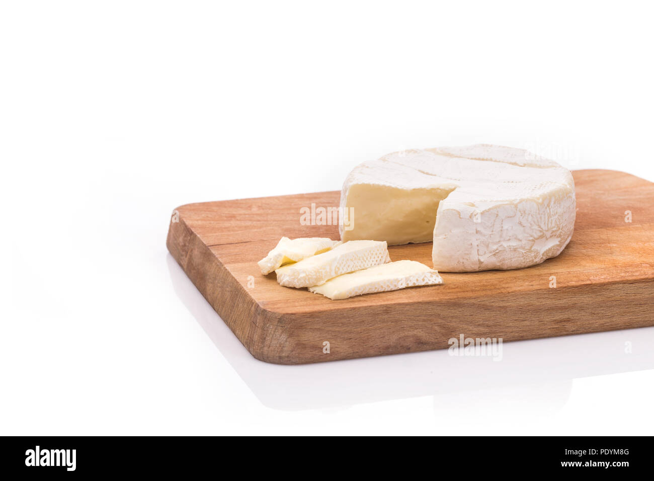 Creamy Brie on rustic wooden background, top view - Stock Image