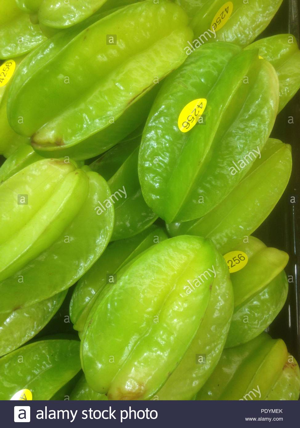 Starfruit (Carambola) for sale at a small market. - Stock Image