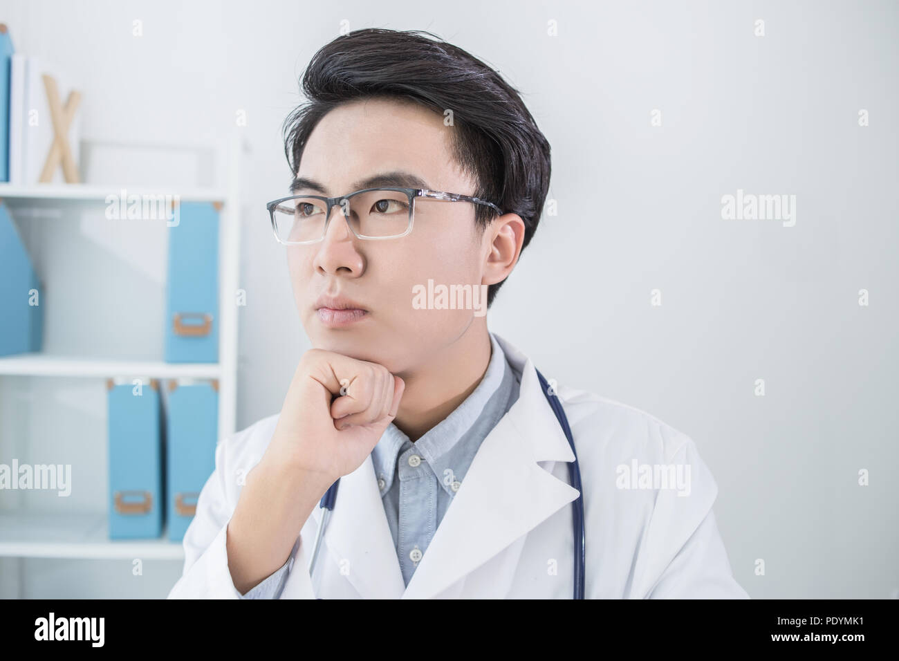 Portrait of a male handsome doctor thinking Stock Photo