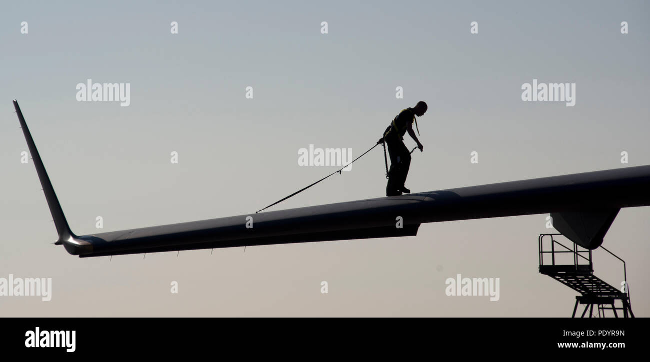 Silhouette of Airman on wing - Stock Image