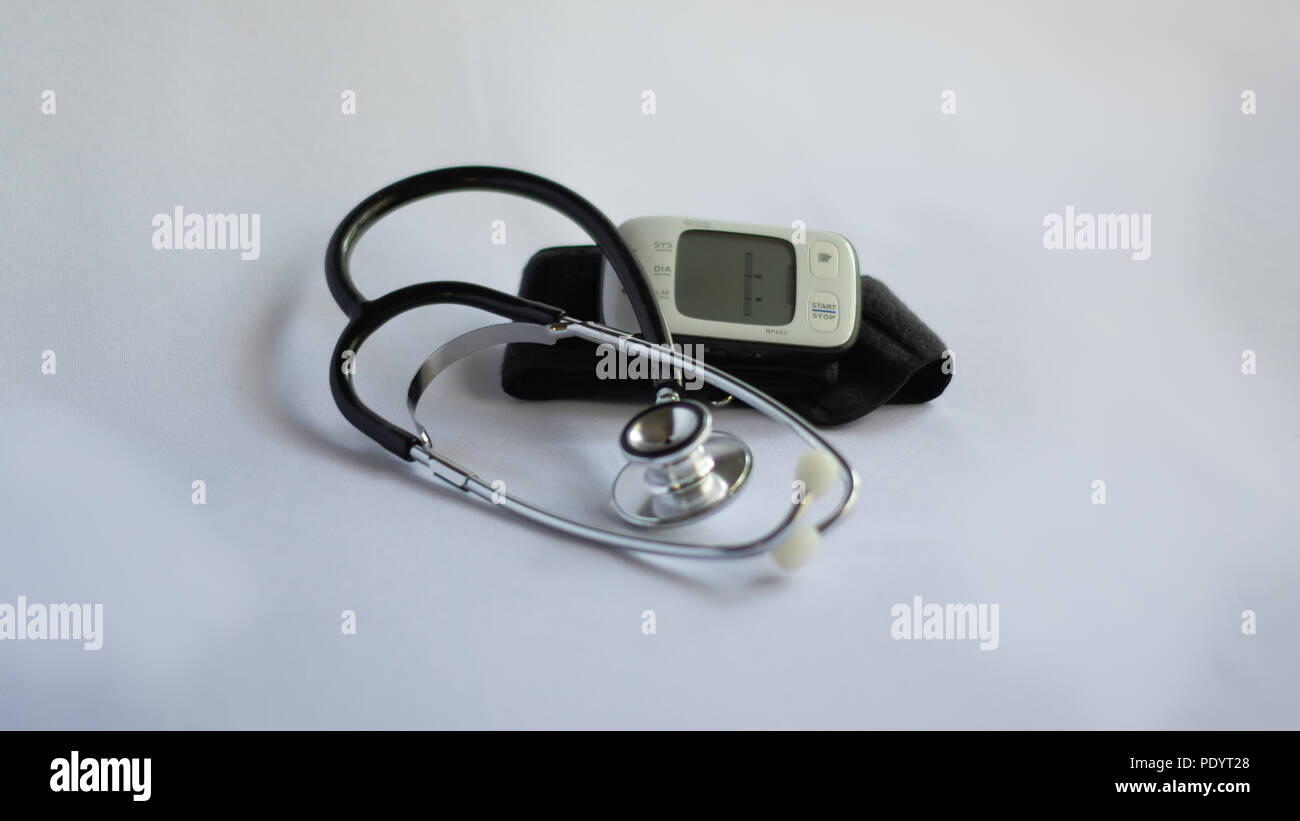 Stethoscope and Blood Pressure Monitor on White Background - Stock Image