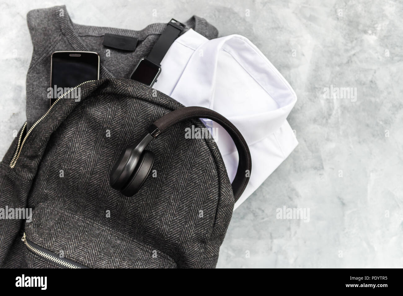 Back to school concept, school uniform such as white shirts and sweater, as well as electronic devices such as smart watch, mobile phone and headphone - Stock Image