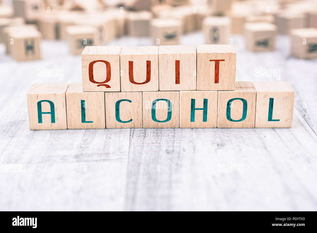 The Words Quit Alcohol Formed By Wooden Blocks On A White Table, Reminder Concept - Stock Image