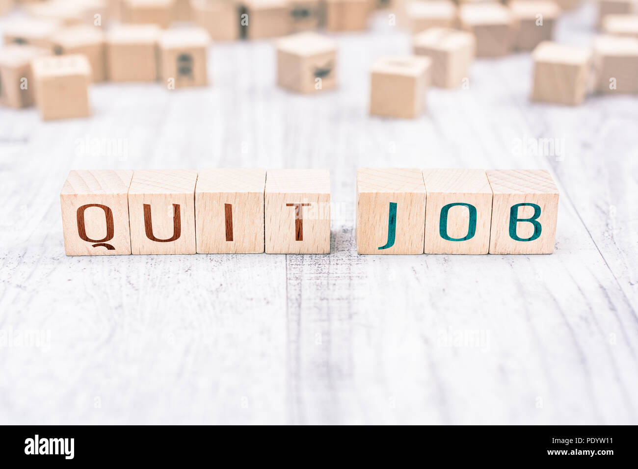 The Words Quit Job Formed By Wooden Blocks On A White Table, Reminder Concept - Stock Image