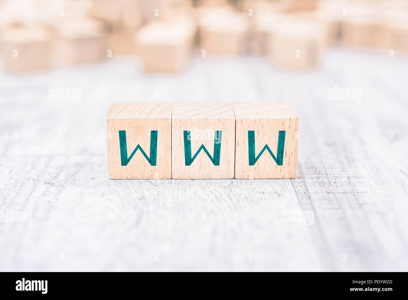 The Word WWW Formed By Wooden Blocks On A White Table - Stock Image