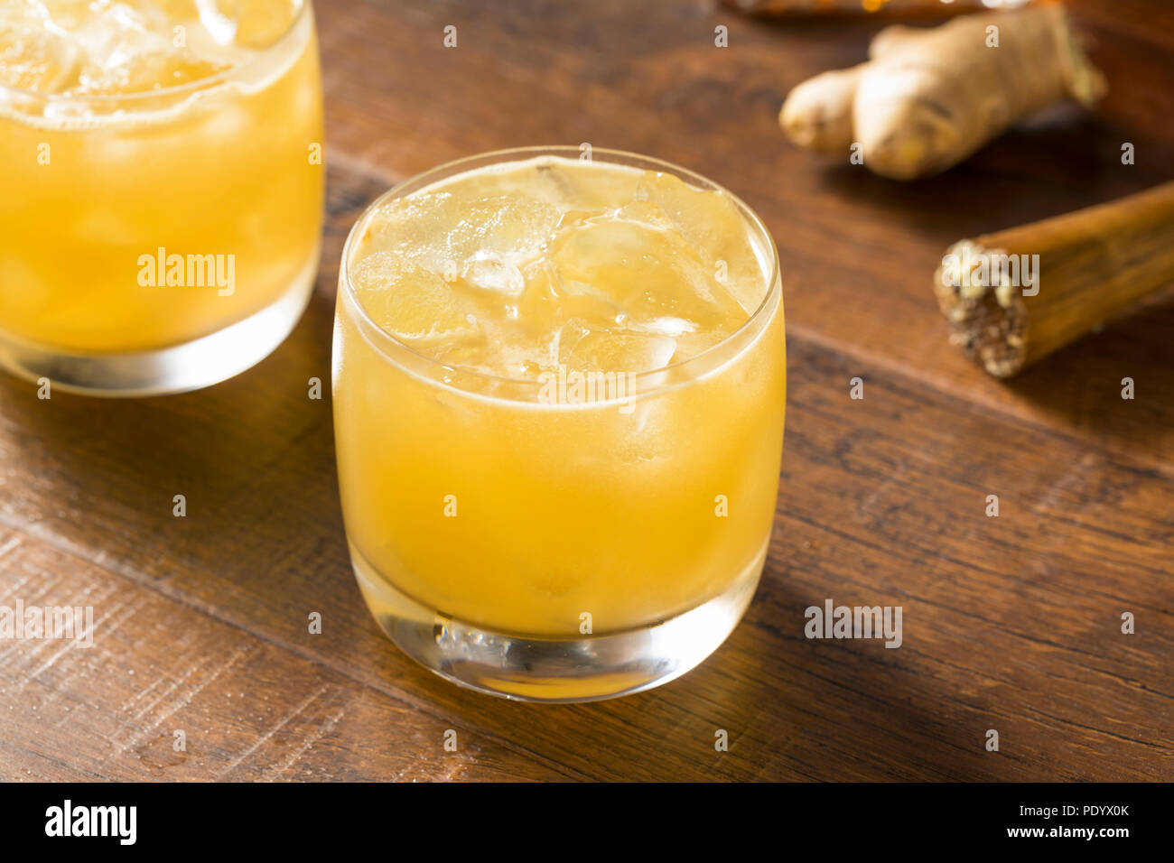 Alcoholic Scotch Penicillin Cocktail with Lemon and Ginger - Stock Image