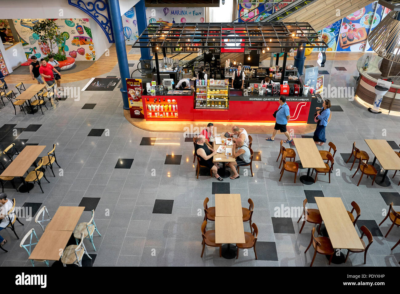 Overhead view of the restaurant dining area in a Thailand shopping mall. Diners from above. Southeast Asia. - Stock Image