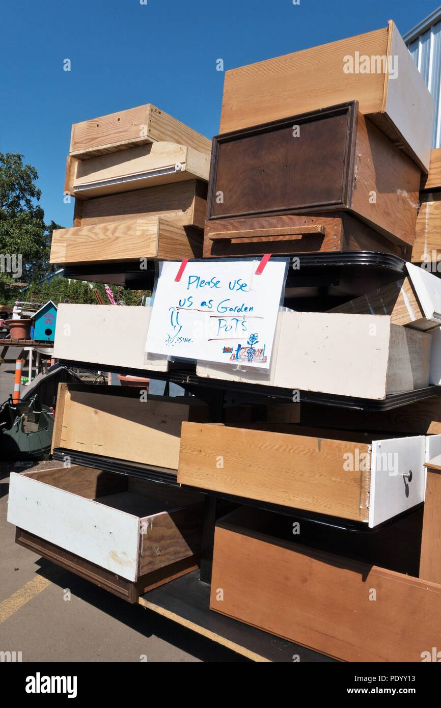 A stack of old drawers to be used as garden pots, at Bring Recycling center in Eugene, Oregon, USA. - Stock Image