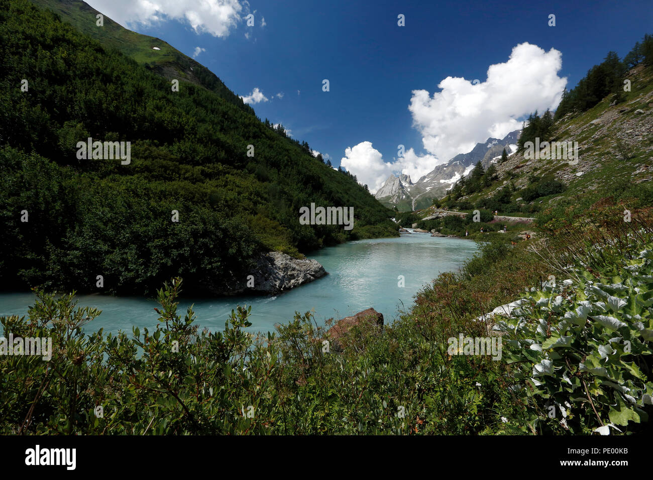 Courmayeur, Aosta Valley, Alpes of Italy : Dora Veny river and the Pyramides Calcaires on the background in a summer morning. - Stock Image
