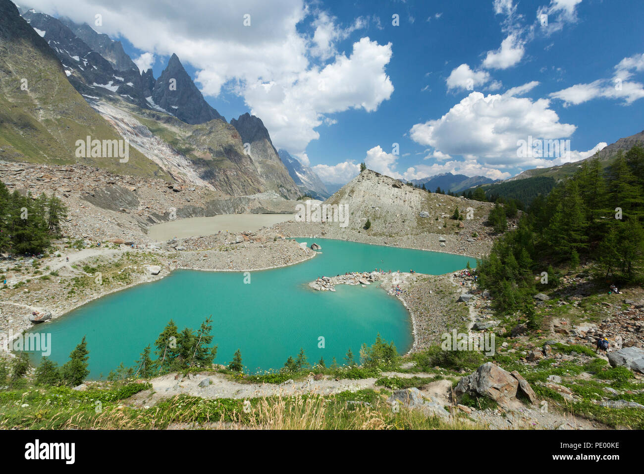 Alpes of Italy, Veny Valley : the Miage Lake and the Peuterey Ridgeline on the background in a sunny day. - Stock Image