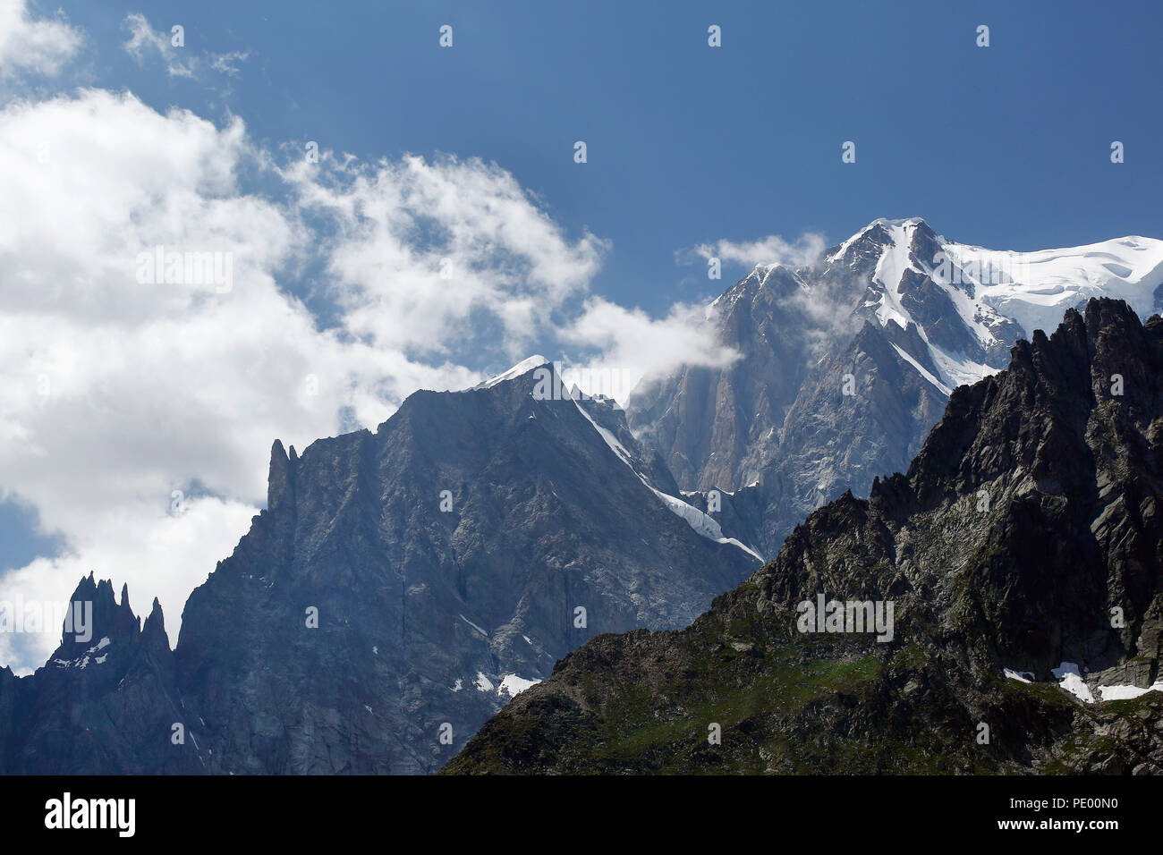 Mont Blanc (Monte Bianco) and the Aiguille blanche de Peuterey in Aosta Valley, Alpes of Italy, in a summer morning. Stock Photo