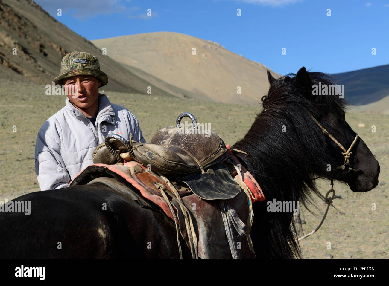 A boy and his horse on the steppe of Mongolia. - Stock Image