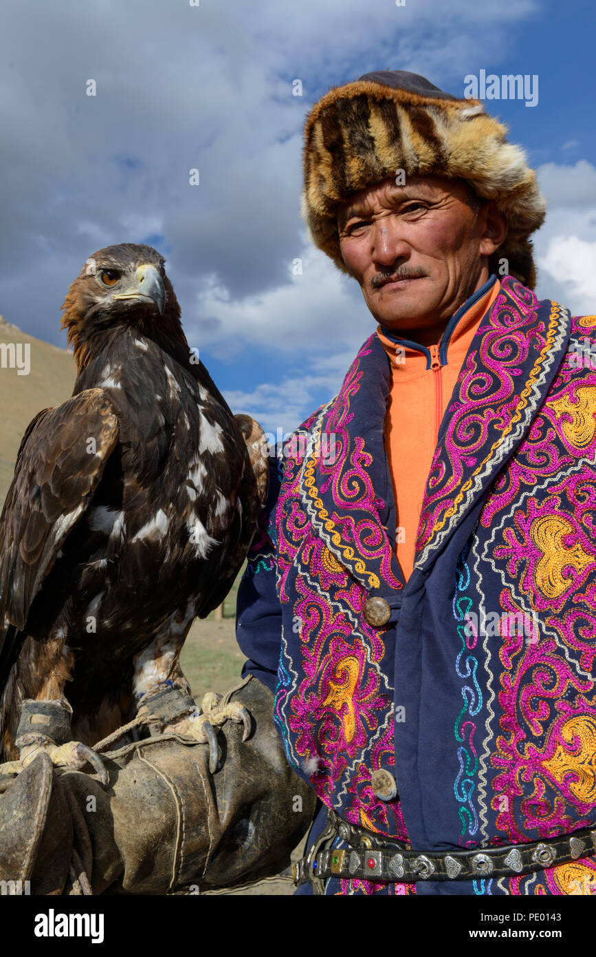 A Kazakh eagle hunter with his golden eagle in Bayan-Olgii, Mongolia. Stock Photo