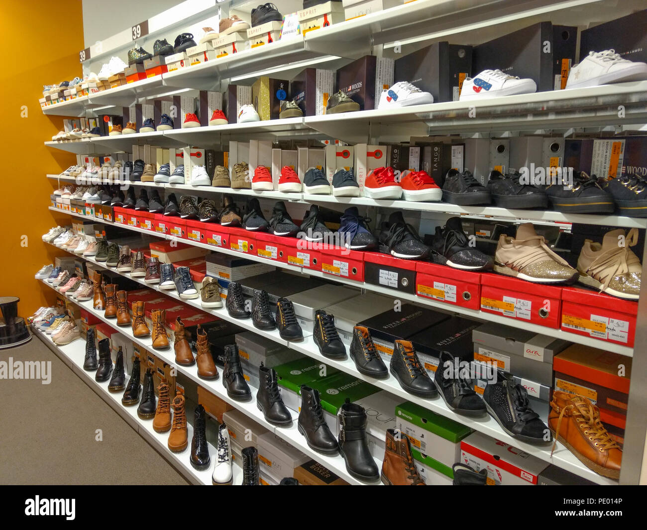 3c2200b3dbf71 Women's shoes displayed on shelves in shoe store. There is a sale going on  so