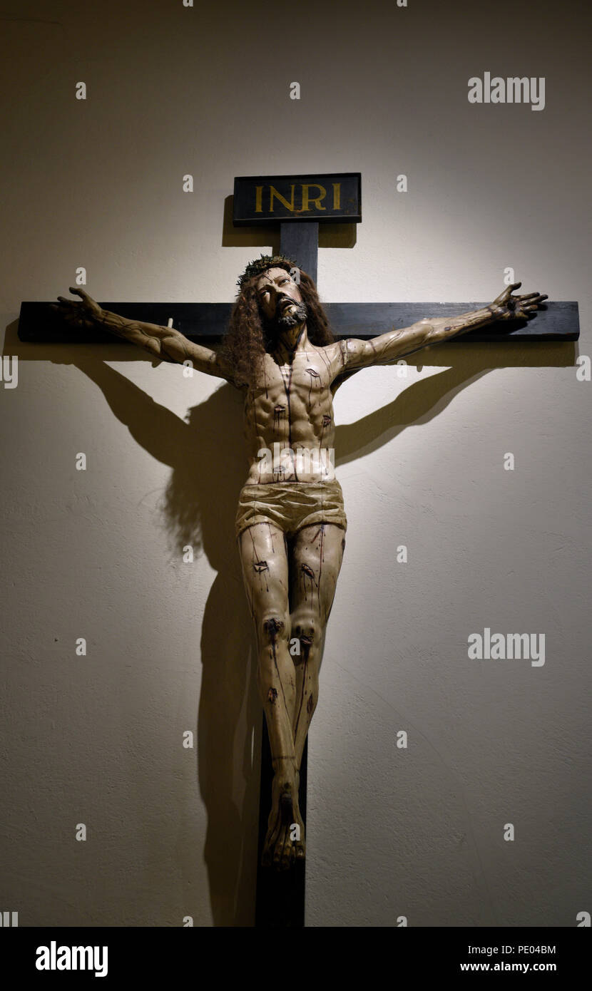 A Wooden Crucifix Mounted On A Wall In The Cathedral Basilica Of St