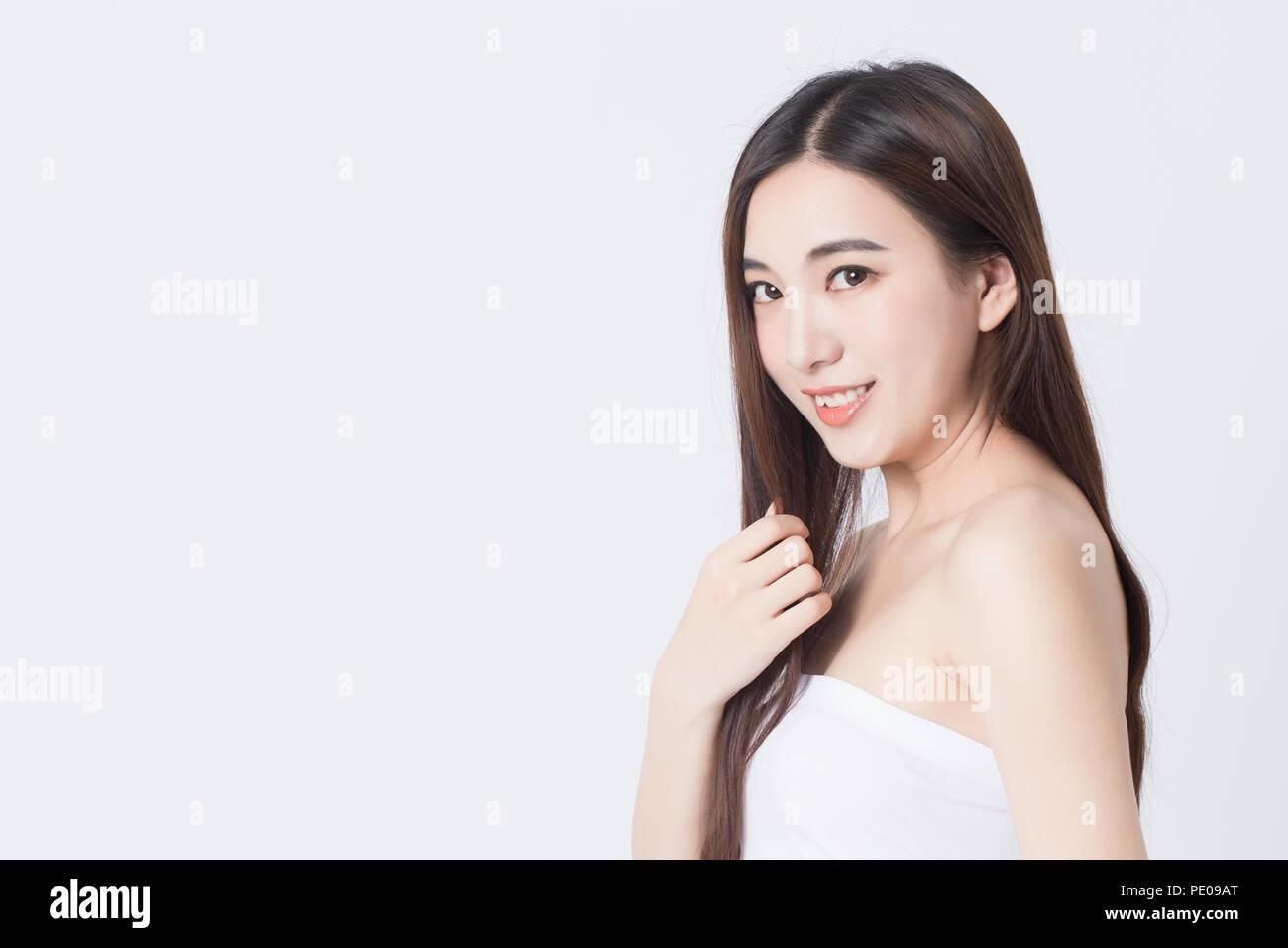 Portrait of beautiful female model on white background - Stock Image
