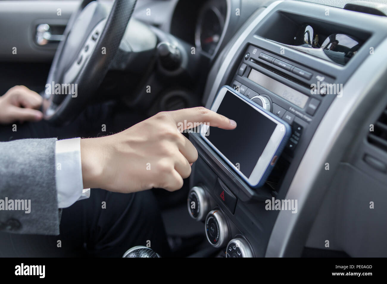 man driving car with navigation system - Stock Image