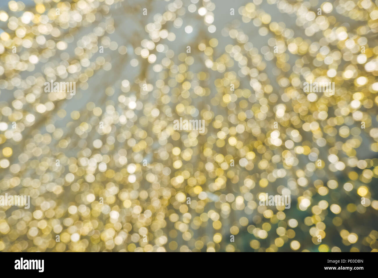 Abstract yellow bokeh circles for Christmas background. Royalty high-quality free stock photo of Christmas light overlay background - Stock Image