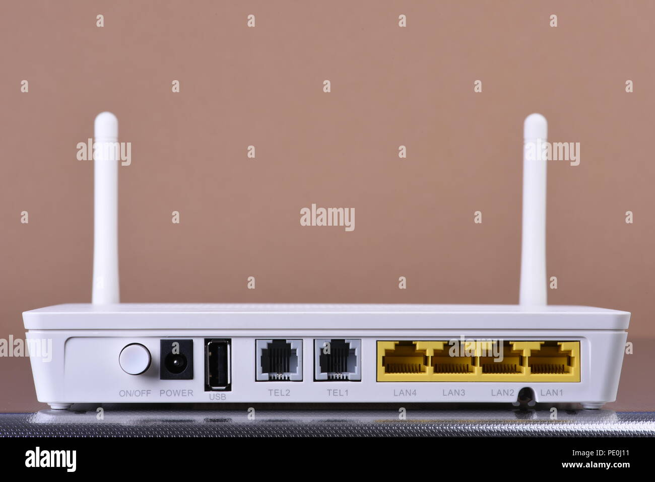 Wireless network router on brown background - Stock Image