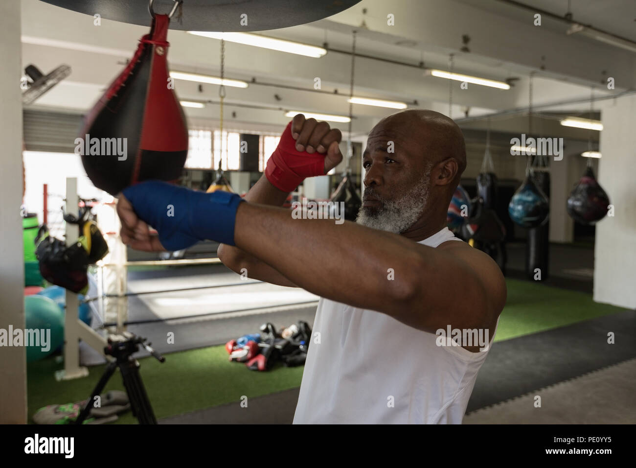 Senior man punching the speed bag - Stock Image