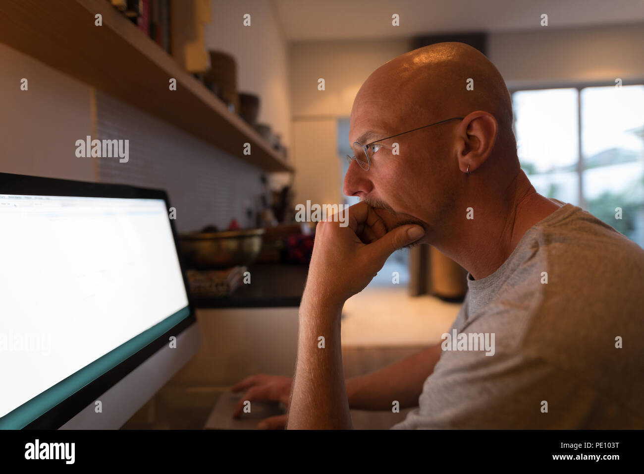 Man working on personal computer - Stock Image