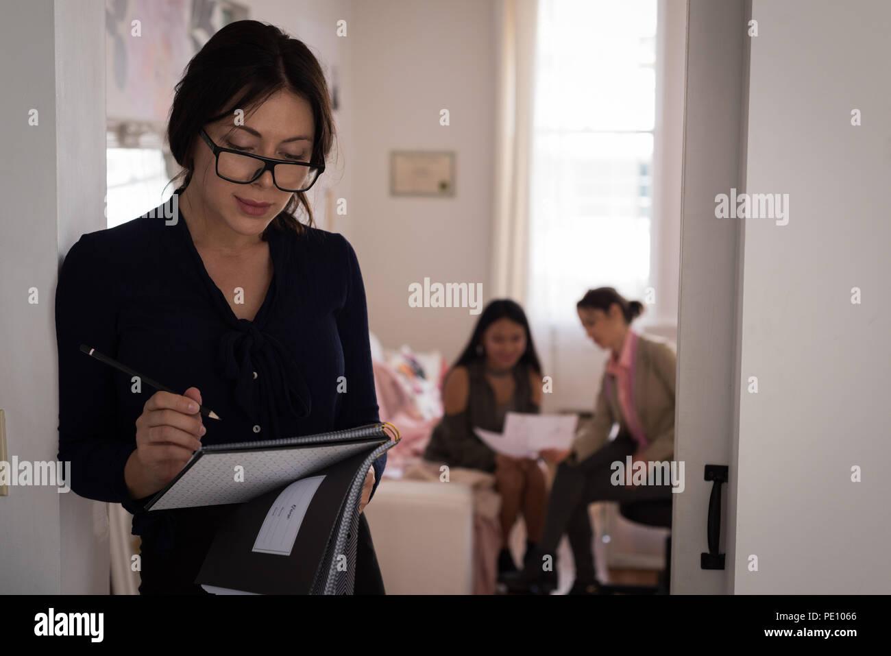 Fashion designer making sketch in the studio - Stock Image