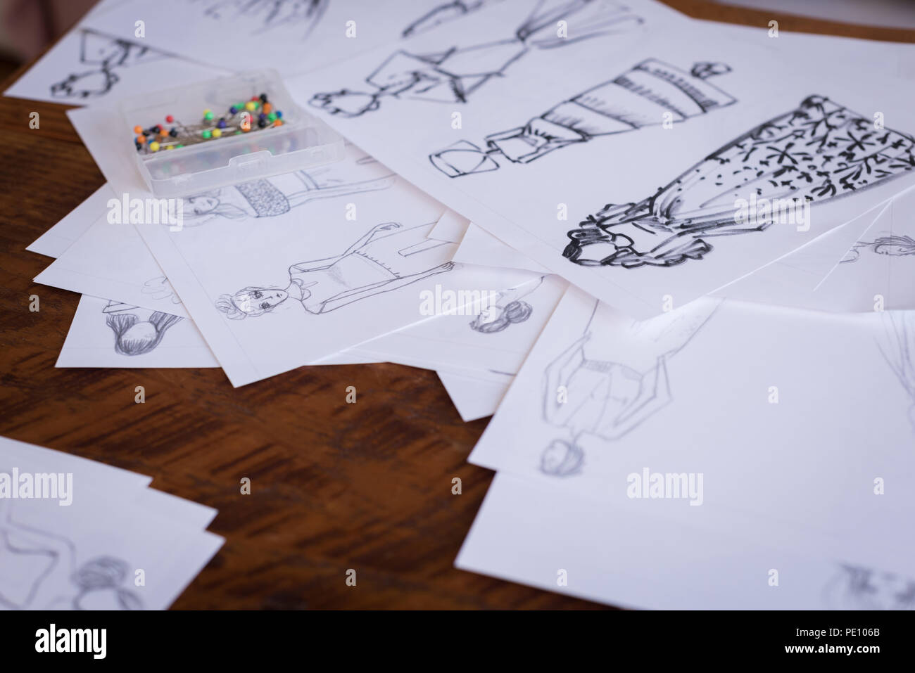 Sketches of design on table in the studio - Stock Image