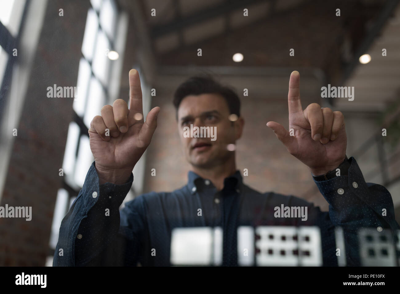 Businessman using an invisible screen - Stock Image
