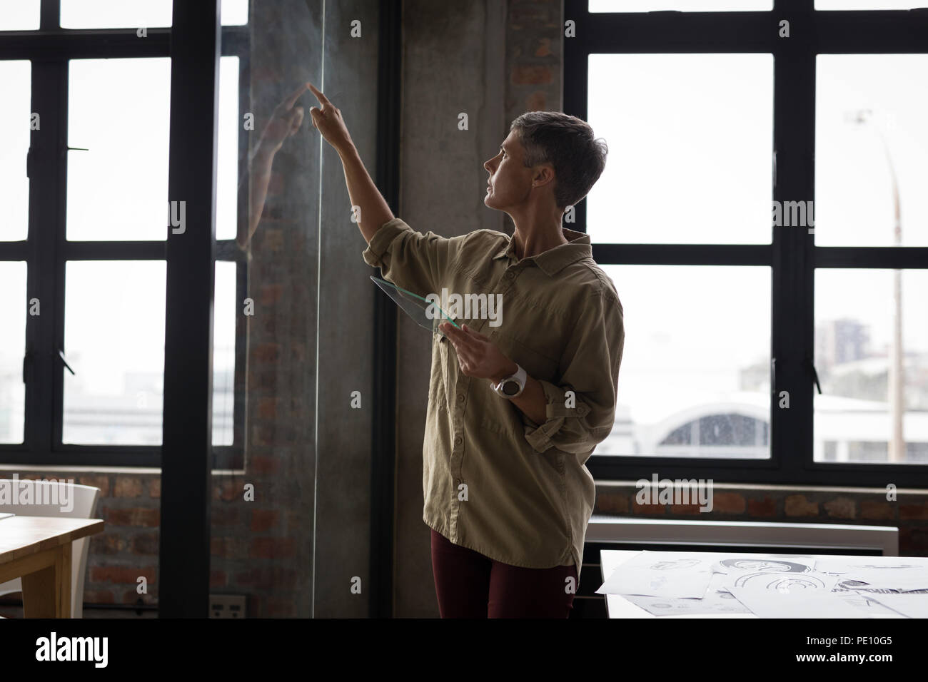 Businesswoman using invisible screen - Stock Image
