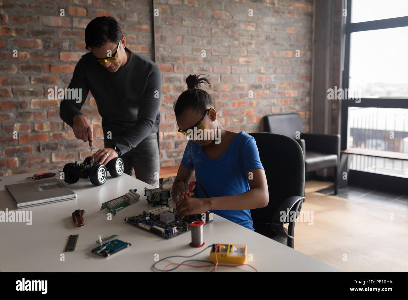 Man Repairing Circuit Board Stock Photos Circuitboardtablejpg Father And Daughter Electric Model Car Image