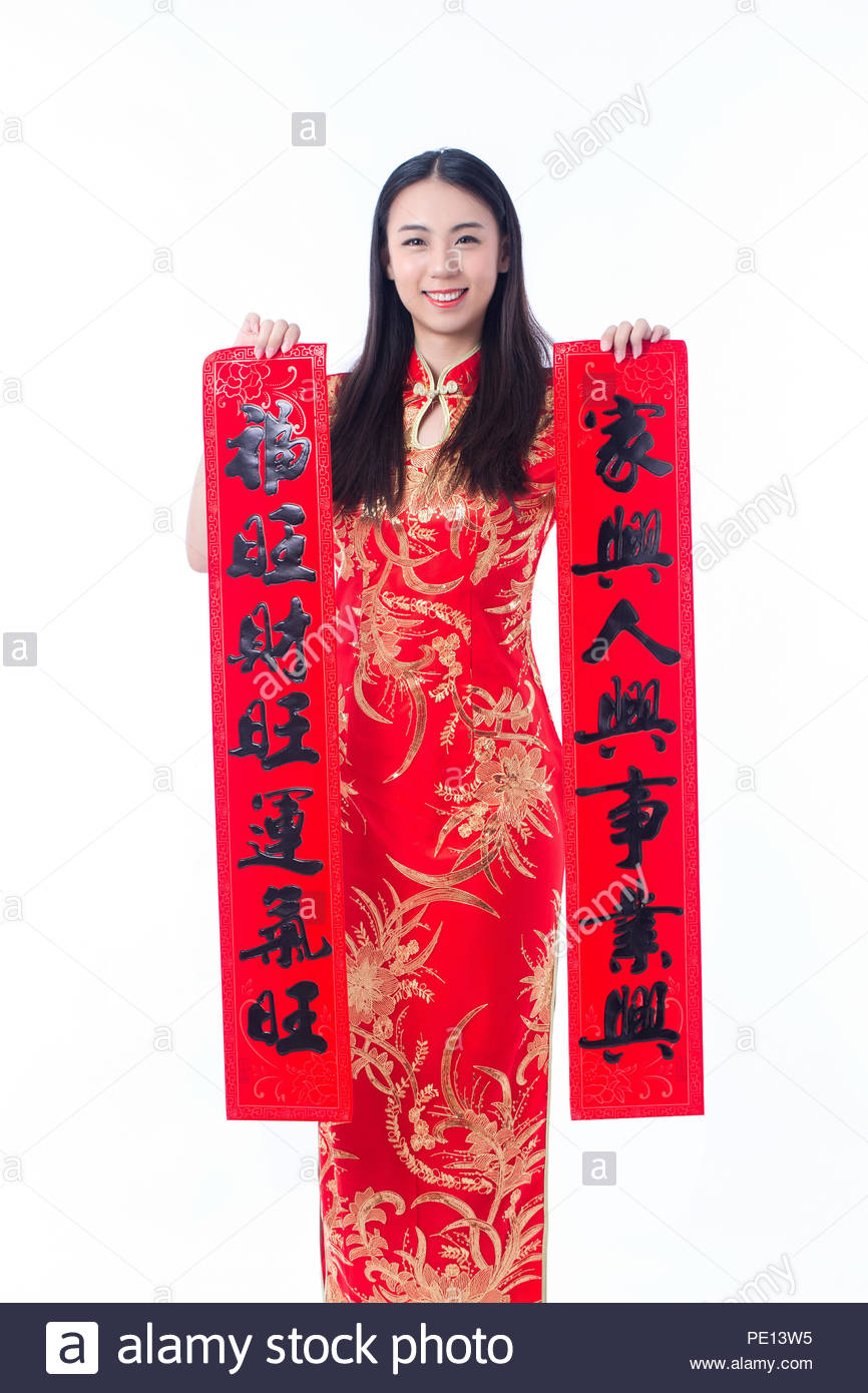 0e756a5bc Chinese girl in traditional Chinese cheongsam holding spring festival  couplets, it says'love and