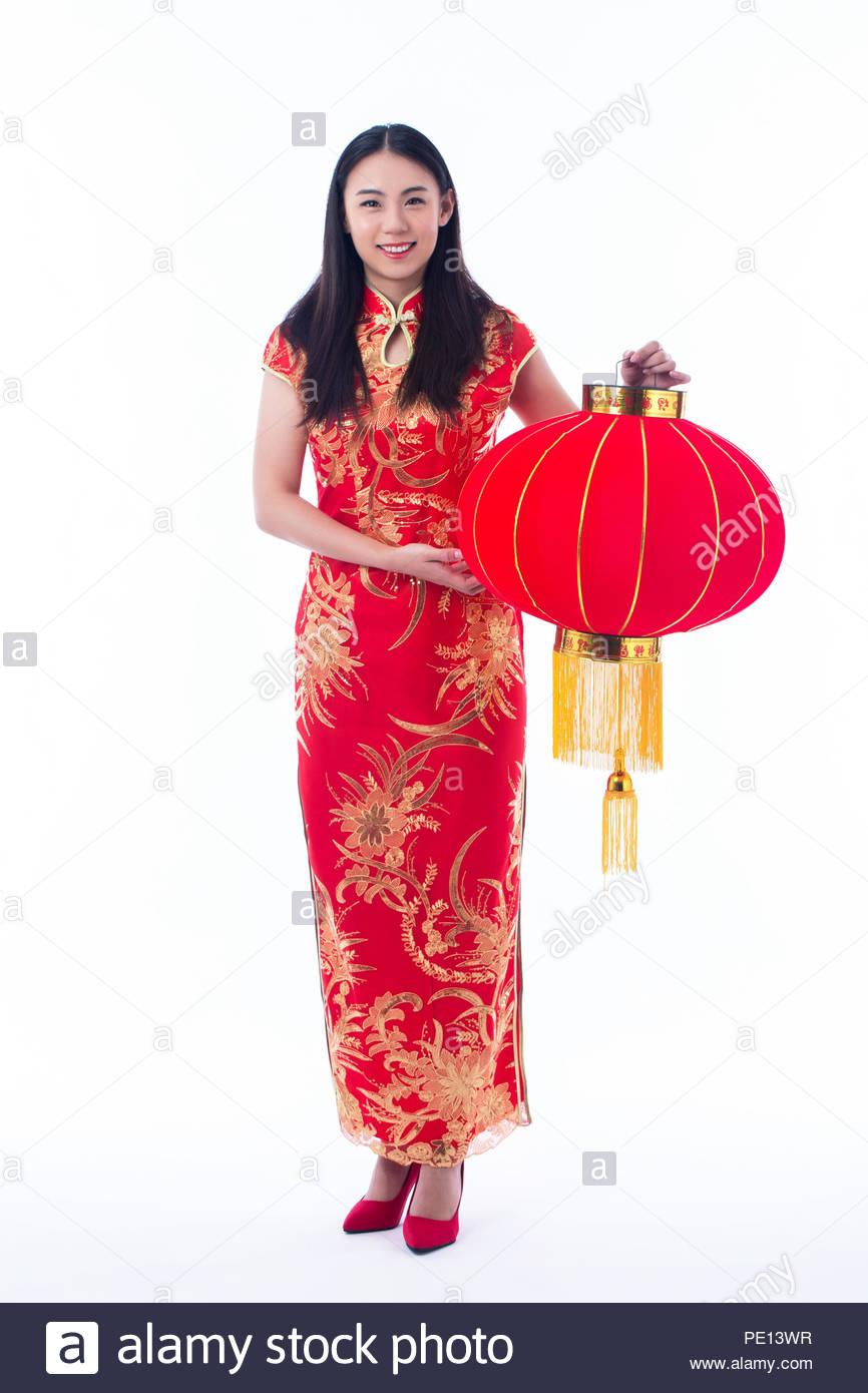 Chinese girl in traditional chinese cheongsam greeting isolated on chinese girl in traditional chinese cheongsam greeting isolated on white background m4hsunfo