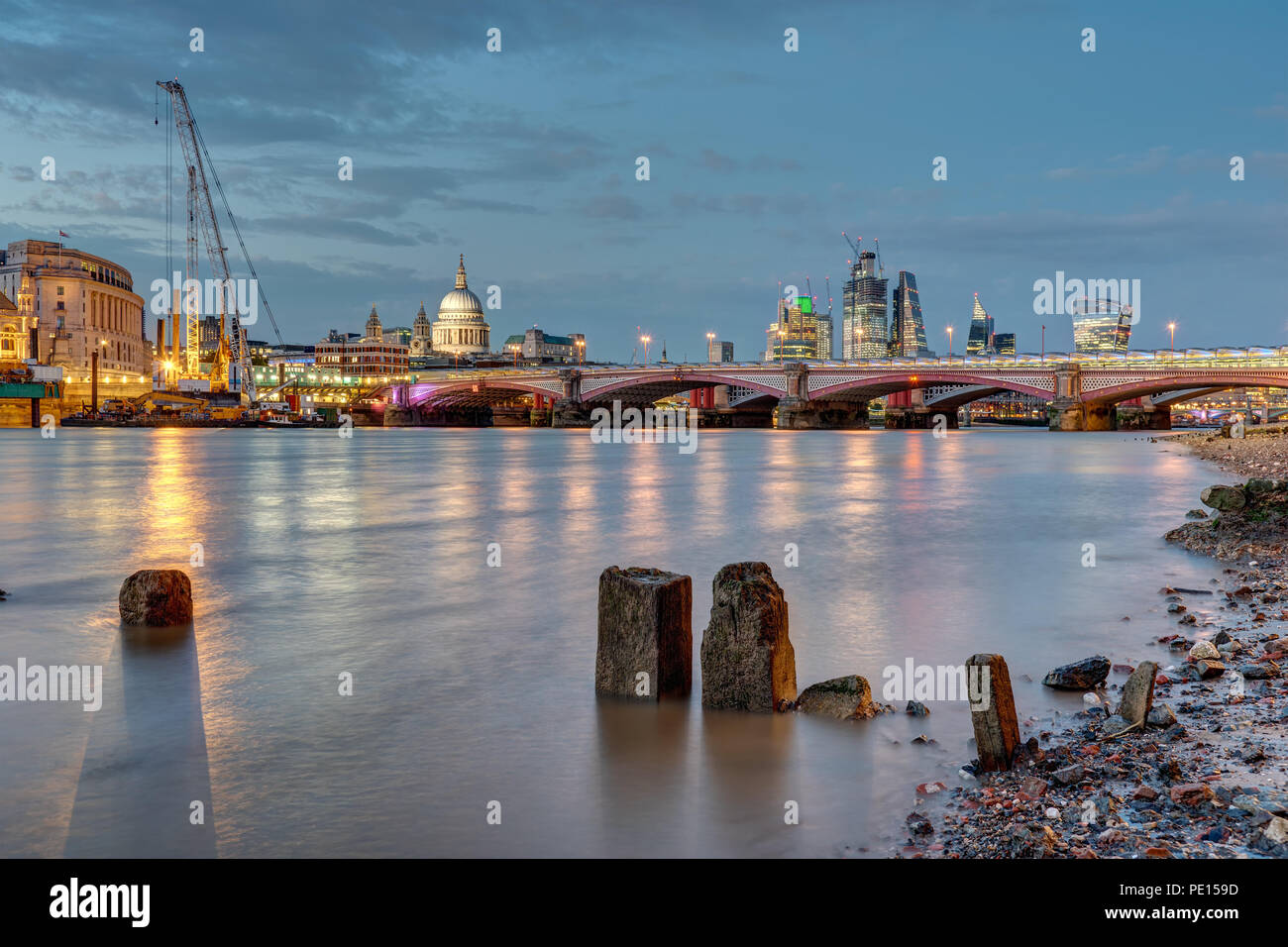 St Pauls cathedral, Blackfriars Bridge and the City of London at dusk - Stock Image