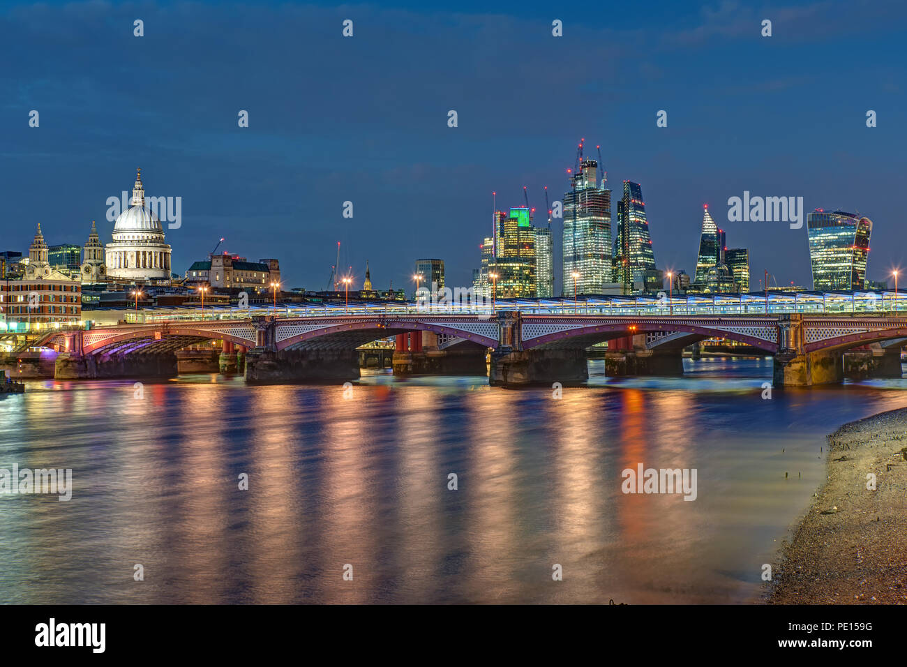 St Pauls cathedral, Blackfriars Bridge and the City of London at night - Stock Image