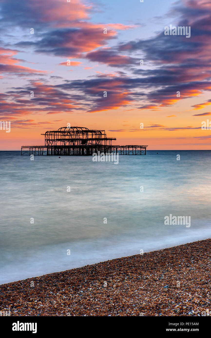 The ruin of the Brighton West Pier seen at sunset - Stock Image