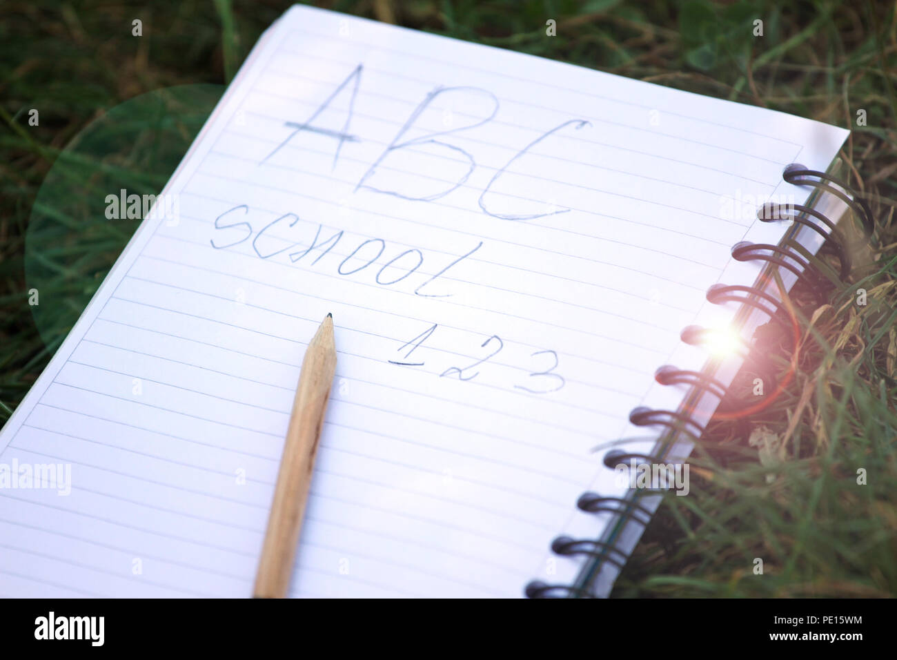 Back to school concept. Education and nature. A B C , school and 1 2 3 write on a notebook. Notebook and a pencil. Copy space for notes. Time for scho Stock Photo