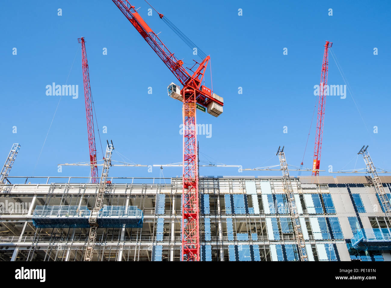 Tower cranes alongside new high rise building at a construction site, Sheffield, England, UK - Stock Image