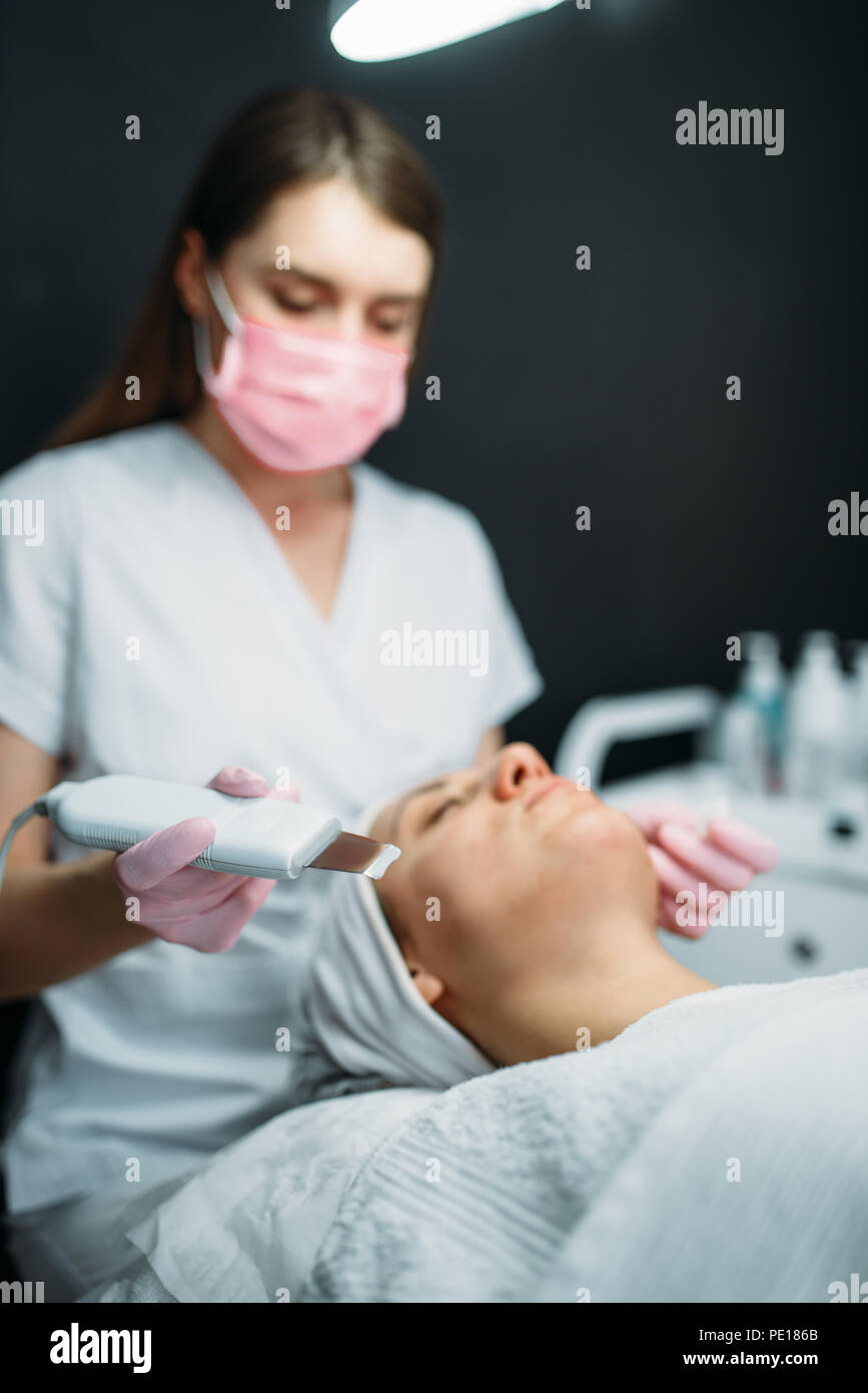 Getting rid of wrinkles in cosmetology clinic. Facial skincare in spa salon, health care. Rejuvenation procedure, beauty medicine - Stock Image