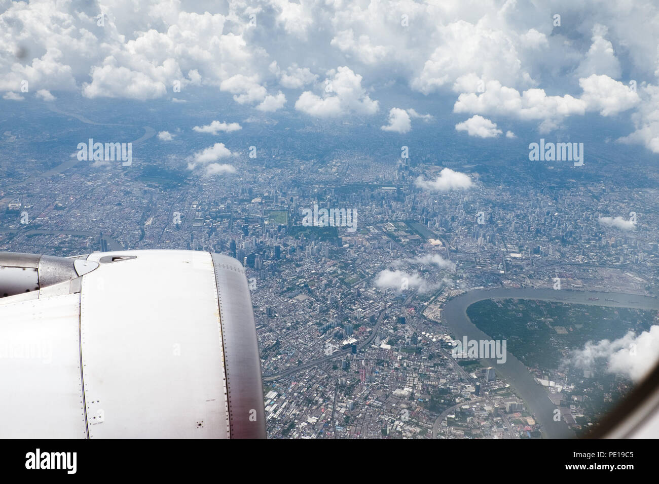 An aerial view over Bangkok, Thailand, from an aeroplane window - Stock Image