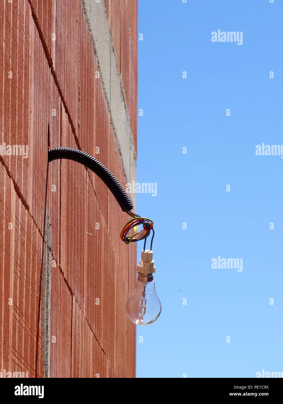 Lightbulb And Wire Shadow On Wall Stock Photos Exterior Wiring Cable Single Light Bulb Hanging From A The Of Newly Built At