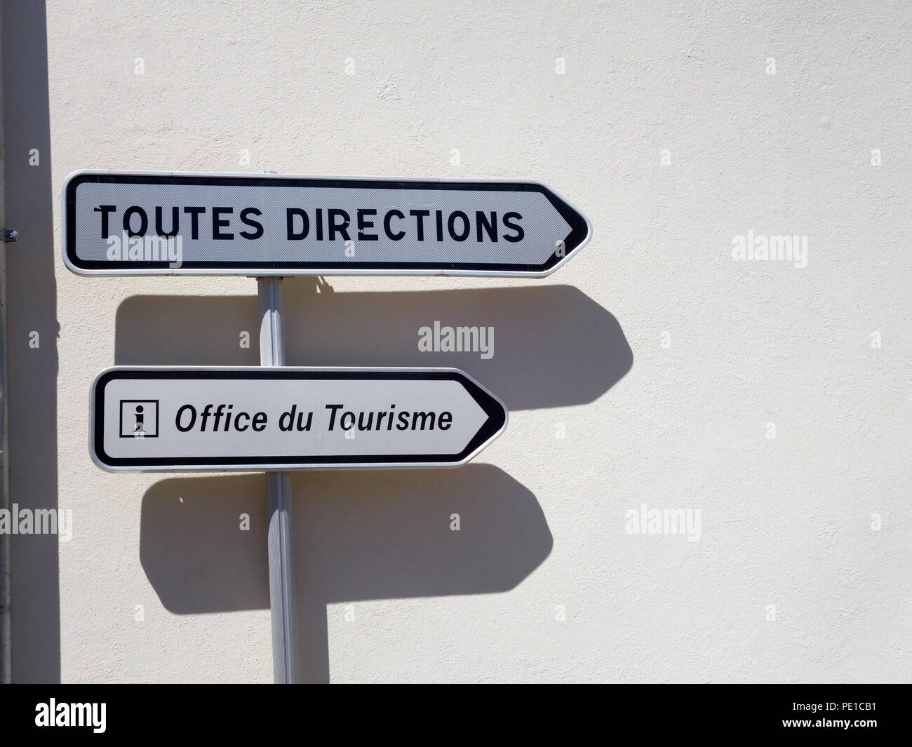 Road direction signs in the small village of Cessenon-sur-Orb, France - Stock Image