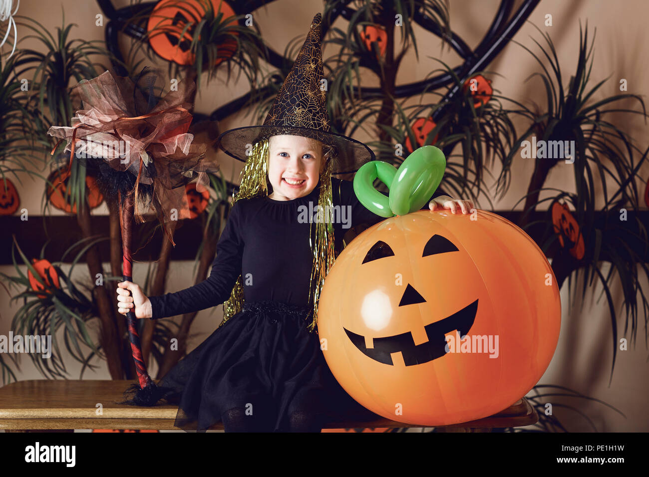 Funny little girl in a Halloween costume - Stock Image