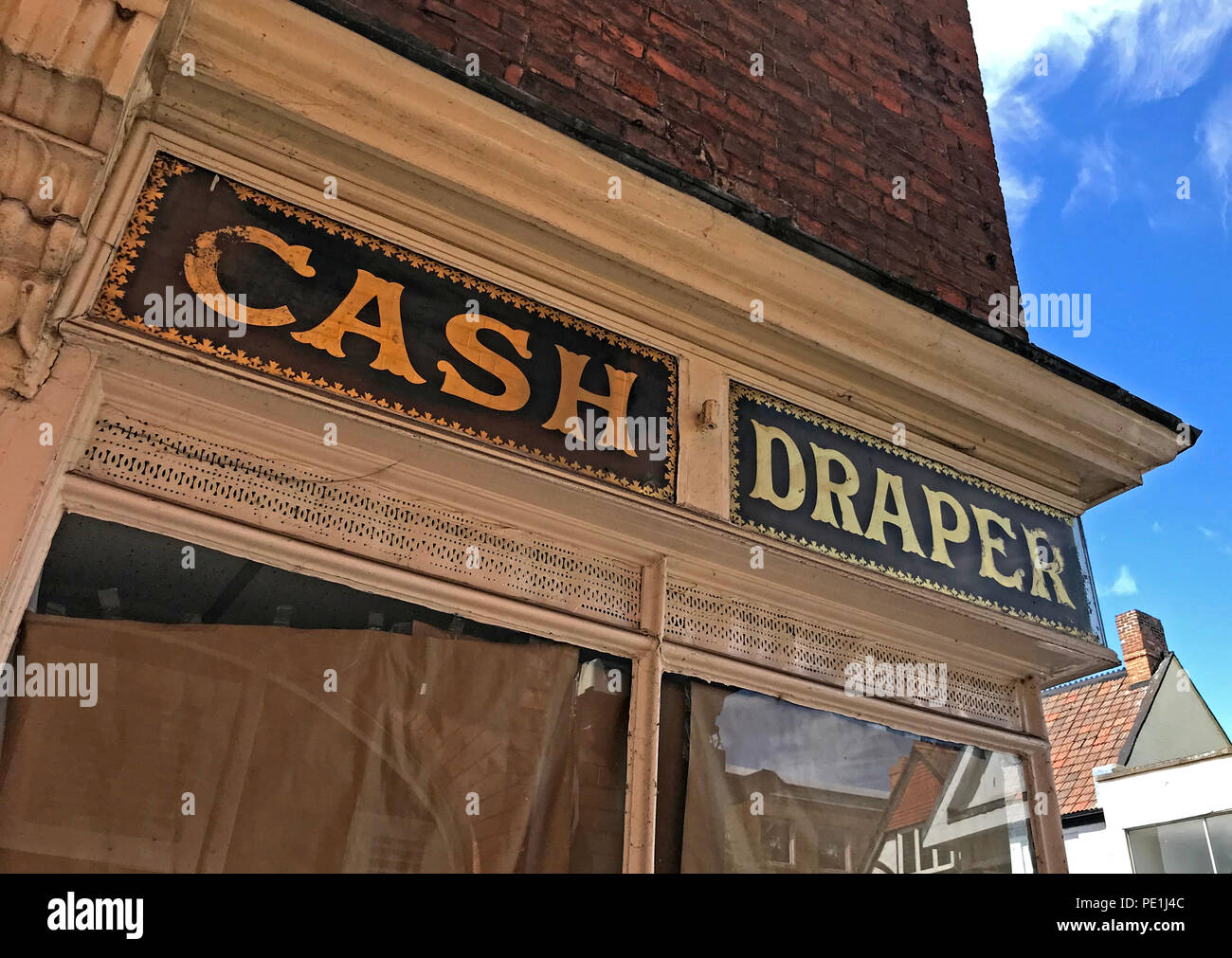 Victorian Cash Draper shop sign, glass and gold leaf, high street, Bridgwater,Somerset, South West England, UK - Stock Image