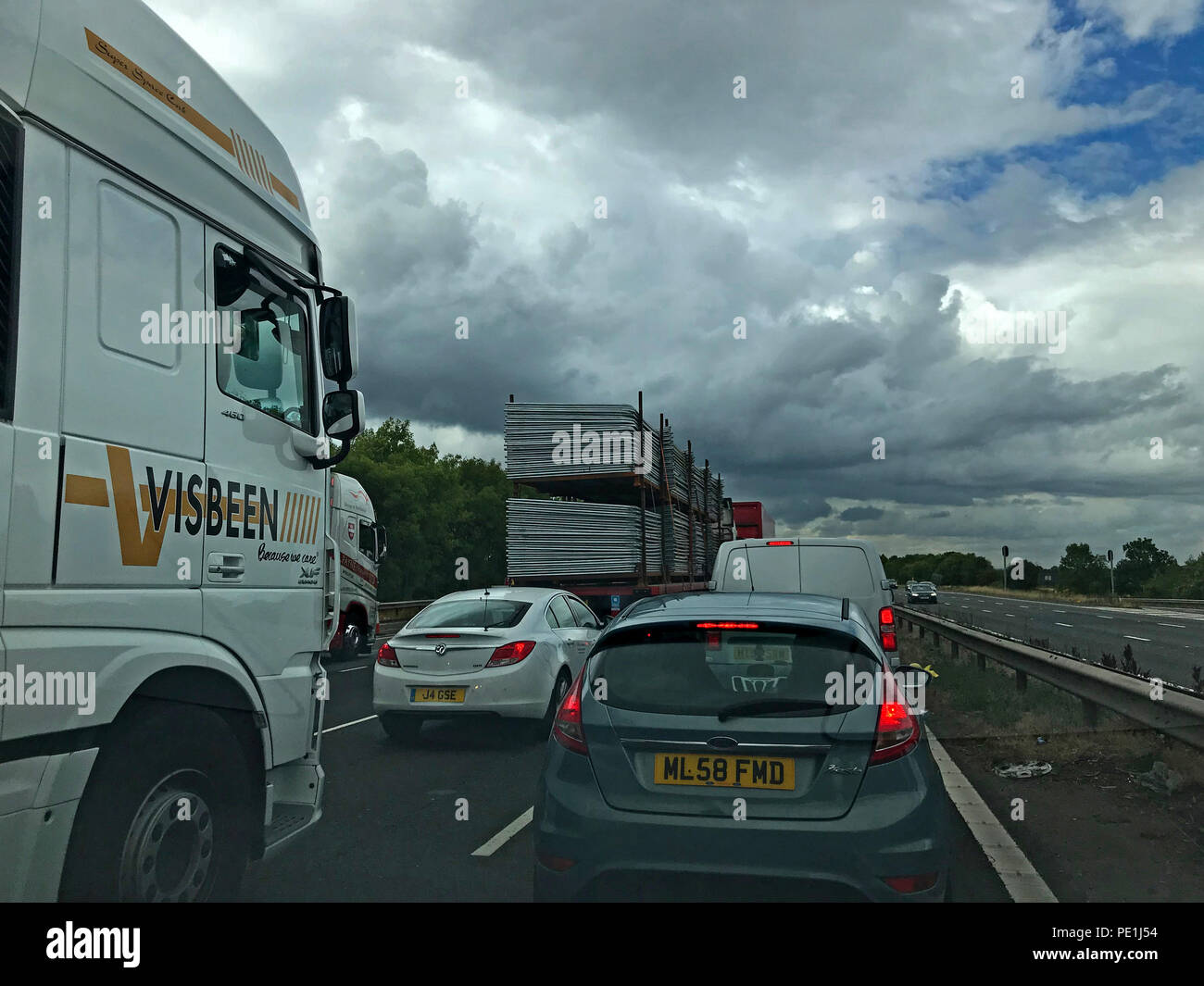 Motorway traffic at a standstill M6, evening traffic delays, North West England, UK - Stock Image