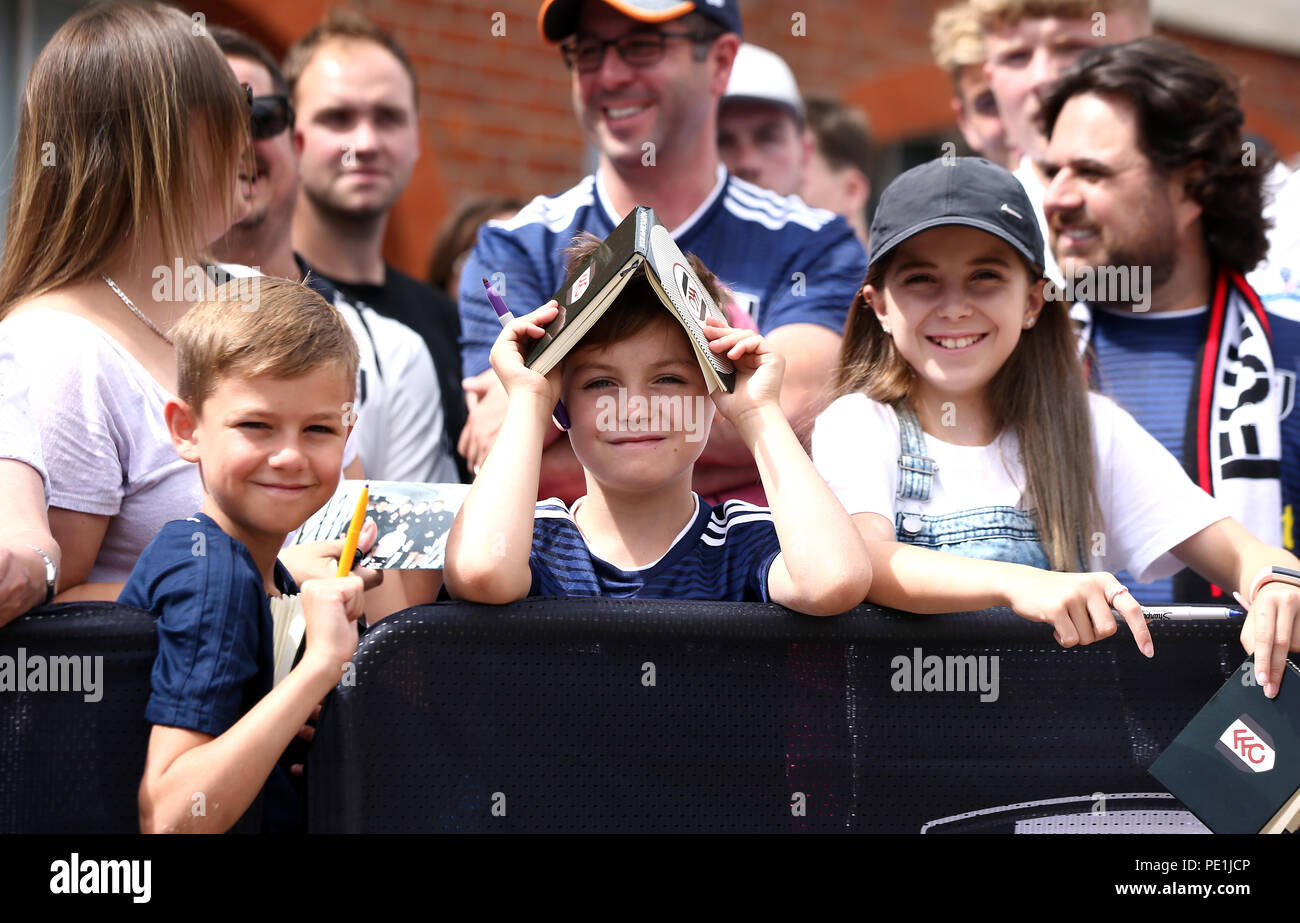 Young Fulham fans outside the ground at the Premier League match at Craven Cottage, London. - Stock Image