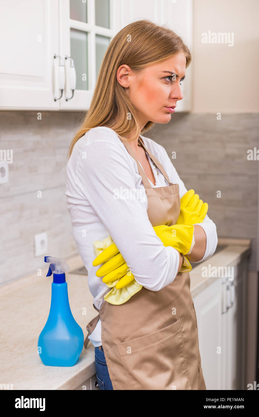 Housewife is angry because she is tired of cleaning and housework. - Stock Image